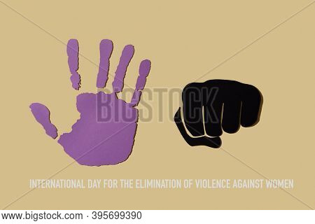 the text international day for the elimination of violence against women and an open hand cut out in a violet paper and a fist, depicting to stop the violence, on a beige background