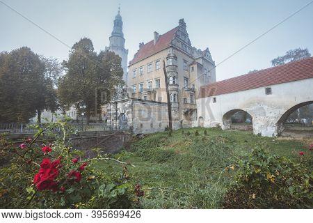 Olesnica Castle In Fog. Olesnica, Lower Silesia, Poland.