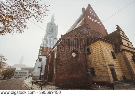 Church In Olesnica In Fog. Olesnica, Lower Silesia, Poland.