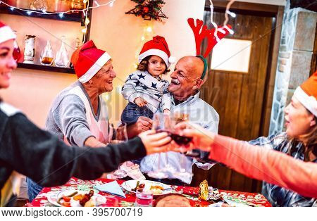 Multi Generation Family Having Fun At Christmas Supper Party - Winter Holiday X Mas Concept With Gra