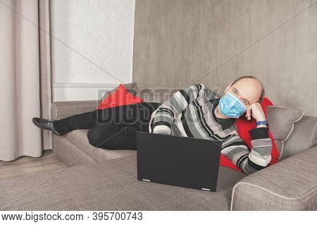 Business Man In Surgical Medical Virus Protection Mask Working At Home