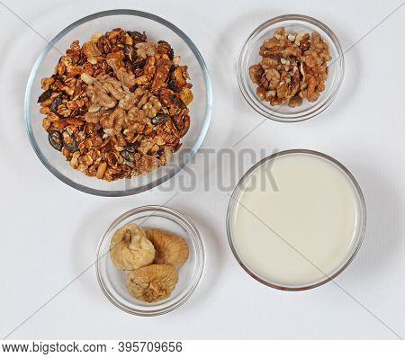 Healthy Mix Of Muesli With Figs In Glass Bowl Top View