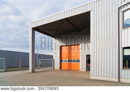 Modern Industrial Warehouse With Orange Roller Door