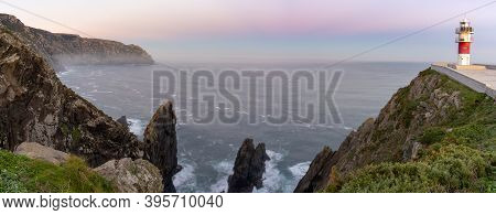 A Panorama Of The Cabo Ortegal Lighthouse On The Coast Of Galicia At Sunset