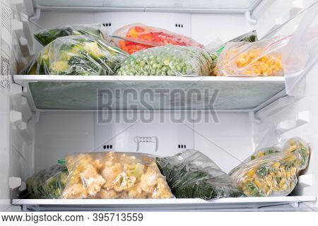 A Set Of Frozen Foods For The Winter. Frozen Vegetables, Corn, Green Peas, Cauliflower, Pepper In Th