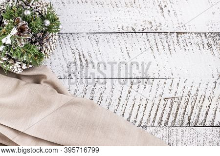 Merry Christmas Concept With Decorative Fir Tree Made Of Cones And Beige Cloth On White Wooden Table