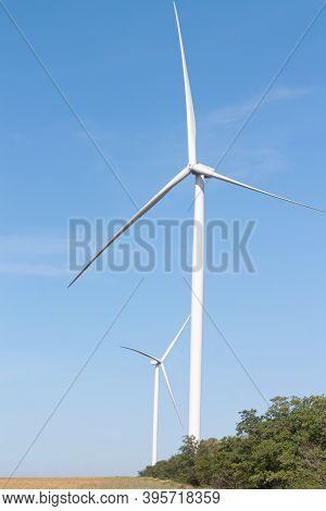 Wind Turbines - Alternative Eco Energy Source. Summer Windfarm Landscape