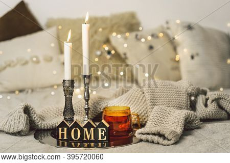 Burning Candles And Cup Tea In Living Room. Seasonal Autumn-winter Concept Of A Cozy Home
