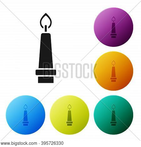 Black Burning Candle In Candlestick Icon Isolated On White Background. Old Fashioned Lit Candle. Cyl
