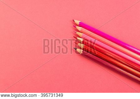 Pink Pencils Placed In Parallel And Inclined Upwards On A Pink Background