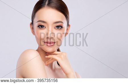 Beautiful Young Asian Woman With Clean Fresh Skin On Face . Chinese Girl Facial  Treatment . Cosmeto