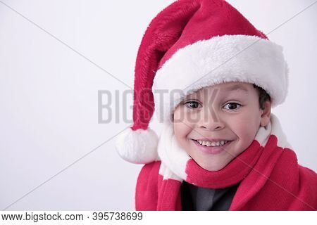 Little Boy With Christmas Hat On His Head With White Background Stock Photo