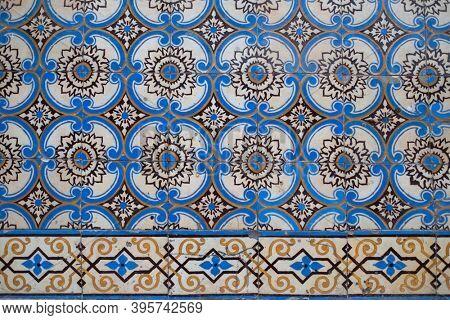 Old tiles wall on the street Portuguese painted tin-glazed, azulejos ceramic tilework. Porto, Portugal.