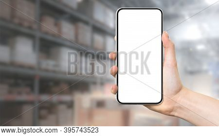 Modern Warehouse Management Template - Female Hand Holding Frameless Smartphone With Blank White Scr