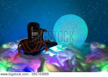 Black Shivalingam Figure In Divali Lights With Rudraksha Beads