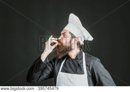Professional Chef Man Showing Sign For Delicious. Male Chef In White Uniform With Perfect Sign. Cook