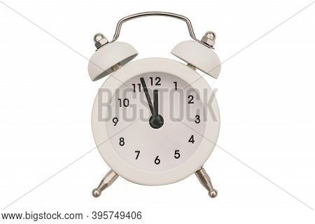 Alarm Clock Close-up Isolated On A White Background. White Round Clock. The Hands Of An Old Alarm Cl