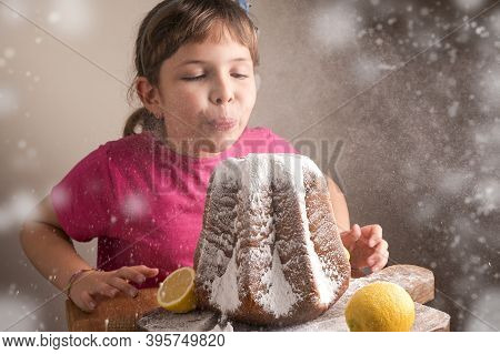 Little Girl Blowing Icing Sugar Off The Soft Star-shaped Pasta. Traditional Italian Pastries From Ve