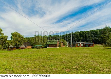 Outskirts Cottage Cabins Building In Idyllic Nature Summer Environment Space With Green Foliage In C