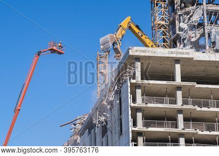 New Orleans, La -  November 17: Workers And Heavy Equipment Demolishing The Collapsed Hard Rock Hote