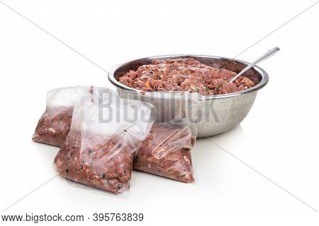 Minced Barf Raw Food Recipe For Dogs Consisting Meat, Organs, Fish, Eggs And Vegetable Are Packaged