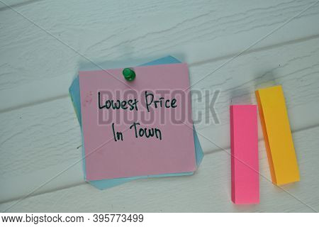 Lowest Price In Town Write On Sticky Note Isolated On Wooden Table. Selective Focus On Lowest Price