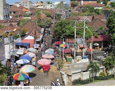 Denpasar, Indonesia - October 5, 2019: People Having Activities Outside Traditional Pasar Badung Bad