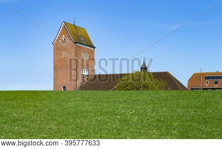 The Photo Shows A Church Behind The Dam On The North Sea Island Baltrum In Germany