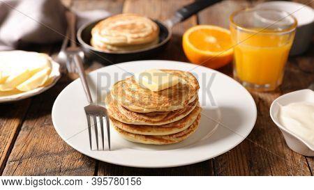 pancake with orange juice on table