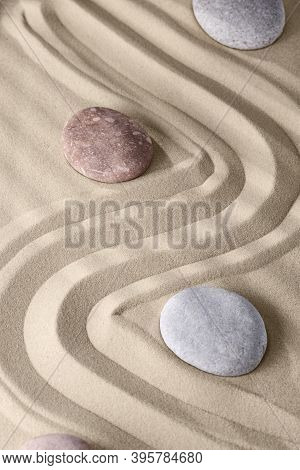 Smooth Lines On The Sand And Round Stones In The Rock Garden, For Relaxation And Spiritual Harmony.