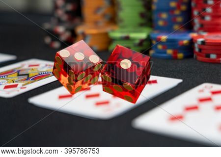 Poker game and rlling dices at the casino gambling table
