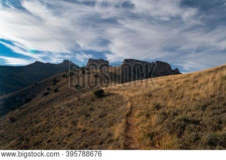 Road Up To Peñas De Herrera During Sunset From The Town Of Talamantes, In Aragon, Spain
