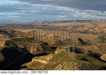 Views Of The Semi-desert Valley Of Huerva With The Windmills Of La Muela And Several Poles And Elect
