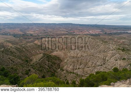 Views Of The Village Of Maria De Huerva And The Semi-desert Valley With Some Pine Trees From A Nearb