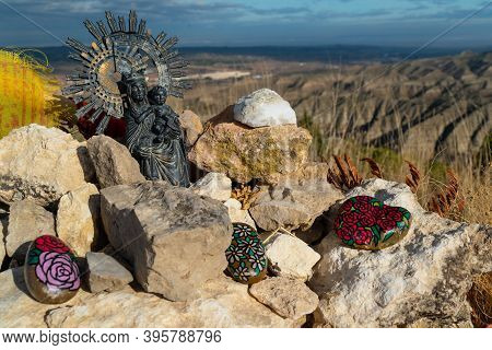 Close Up Of The Big Landmark On Top Of Cabezo Del Sillon With A Virgin Del Pilar, Offerings And Budd
