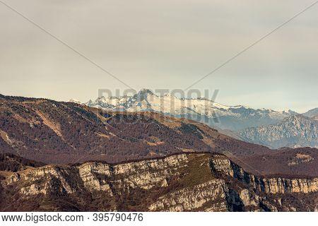 Italian Alps With The Mountain Range Of Monte Baldo And Adamello With The Peak Of Care Alto Photogra