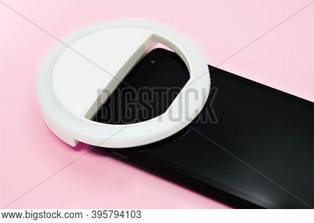 Led Selfie Circular Ring Light Lamp On Smartphone On Pastel Pink Background. Clip-on Flash Light Cam