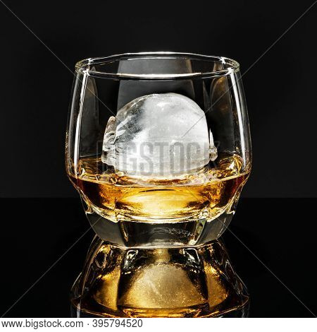 Whisky with sphere ice fancy cocktail