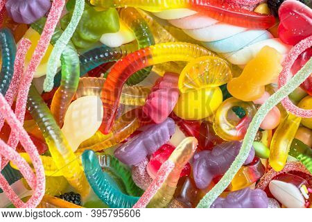 Closeup of colorful assorted jelly worms and other candies