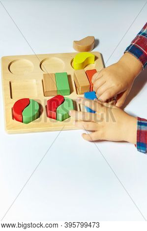 The Child Collects A Sorter. Educational Logic Toys For Kid\\\'s. Children\\\'s Hands Close-up. Mont