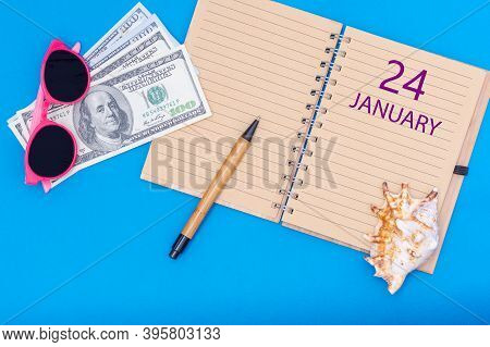 January 24. January 24th. Travel Plan Flat Design With Notepad Written Date, Pen, Glasses, Money Dol