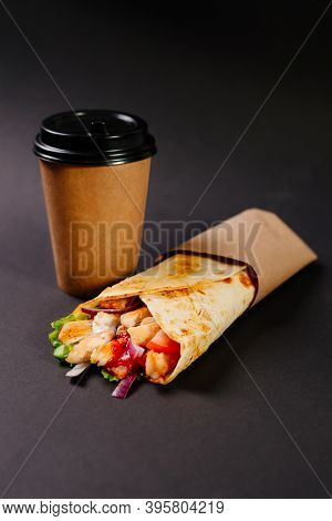 Chicken Shawarma And Drink In A Paper Cup On A Dark Background. Lunch At A Street Cafe. Fast Food Ca