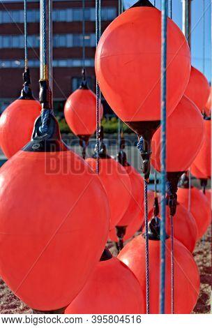 Orange Fender Balls For Ships Protection When Docking, Close Up.