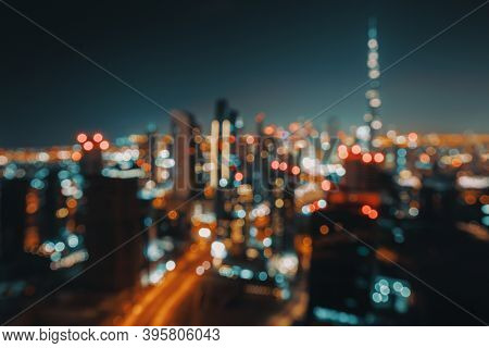 Blur Nighttime Cityscape. Abstract Background of an Urban Night Scene. Bokeh Lights. Modern City of Dubai. United Arab Emirates.