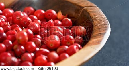 Whole Pink Red Peppercorns In Small Wooden Bowl, Closeup Detail