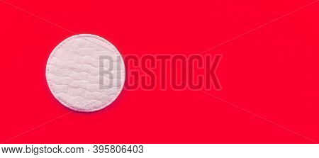 White Cotton Hygienic Pad On Red Board, Closeup Detail From Above, Space For Text Right Side