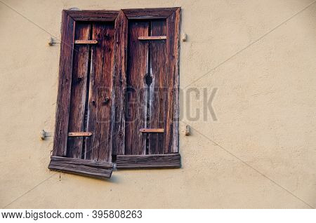 Window With Old Closed Shutters In Bright House Wall. High Quality Photo. Copy Space For Characters