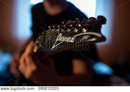Miercurea Ciuc, Romania- 21 November 2020: Young Musician Playing On Ibanez Electric Guitar.