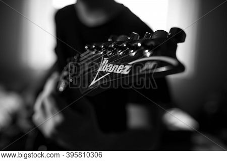 Miercurea Ciuc, Romania- 21 November 2020: Monochrome Image, Young Musician Playing On Ibanez Electr