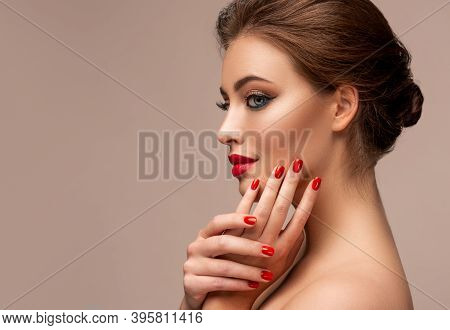 Beautiful Woman Showing Red Lips And   Manicure Nails .blue Eyed  Model Girl .  Evening Bright Makeu